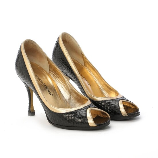NOT SOLD. Dolce & Gabbana: A pair of open stilettos made of black python and gold coloured leather with open toe and thin heel. Size 36 ½. – Bruun Rasmussen Auctioneers of Fine Art