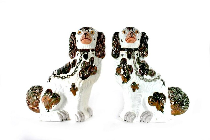 PAIR OF LARGE STAFFORDSHIRE EARTHENWARE SPANIELS