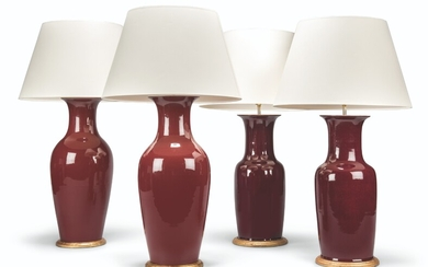 TWO PAIRS OF CHINESE SANG-DE-BOEUF VASES, MOUNTED AS LAMPS