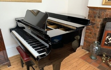 Yamaha (c1974) A 6ft 1in Model C3 grand piano in a bright eb...