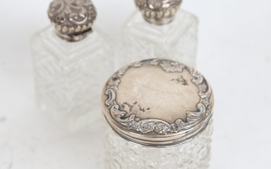3 cut-glass and embossed silver-mounted scent bottles, and a...