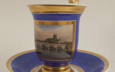 A 19th century French porcelain cup and saucer, with a blue ...