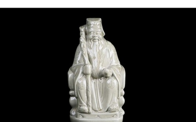 A 20th-century Chinese celadon glazed pottery figure of a se...