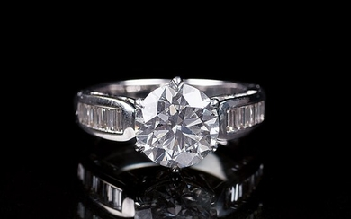 A Diamond Ring with a Solitaire Diamond.