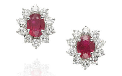 A PAIR OF RUBY AND DIAMOND STUD EARRINGS