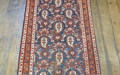 A Persian blue ground rug, with multiple borders, centre wit...