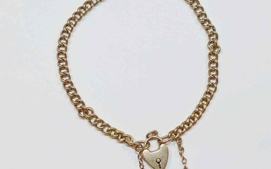 A curb link bracelet, with heart shaped padlock clasp stampe...
