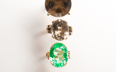 A group of gemstone and fourteen karat white or yellow gold rings