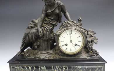 A late 19th century cast spelter, slate and marble mantel clock with eight day movement striking on