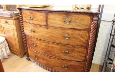 A late Regency mahogany bow fronted chest of two short and t...