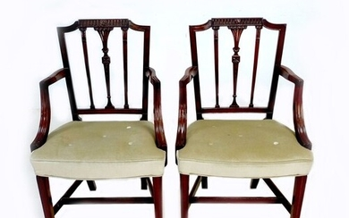 A pair of 19th century open armchairs, with carved rails and...