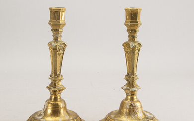 A pair of French Rococo 18th century candlesticks.
