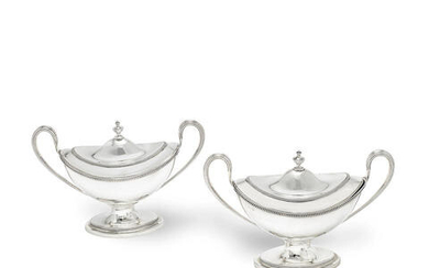 A pair of George III Irish silver covered two-handled sauce tureens