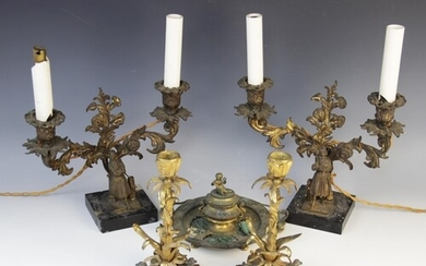 A pair of mid 19th century ormolu candlesticks, cast in the ...