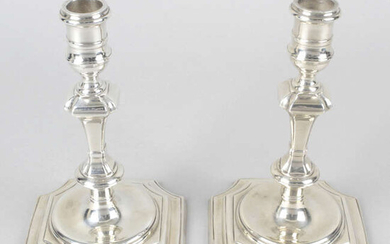 A pair of modern silver reproduction candlesticks.