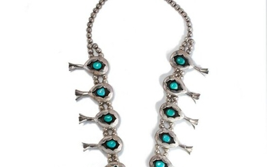 A turquoise and silver necklace