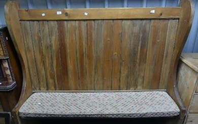 A vintage pine high back Settle, with scrolling end supports...