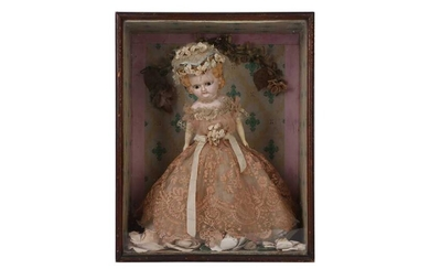 AN EARLY 20TH CENTURY BISQUE DOLL IN DISPLAY CASE