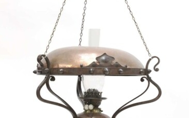 An Arts and Crafts hanging copper oil lamp