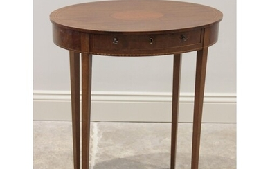An Edwardian mahogany oval occasional table, the top with ov...