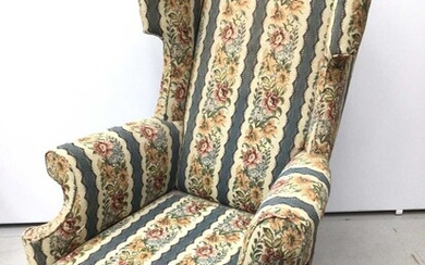 Good quality Georgian style wing back armchair with floral upholstery on carved mahogany legs with claw and ball feet