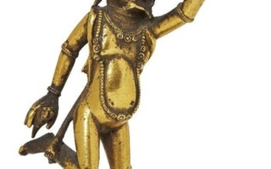 Property of a Gentleman (lots 36-85) A Tibetan gilt-bronze bardo Simha-headed dancing deity, 17th century, richly gilded and cast in energetic posture holding a ritual chopper and a kapala, 9cm high, on metal stand Provenance: Ex Seward Kennedy...