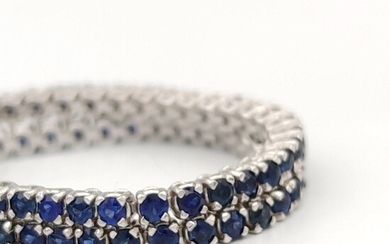 18 kt white gold tennis bracelet with sapphires
