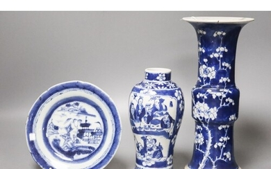 A Chinese blue and white gu vase, a baluster vase and a dish...