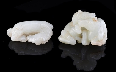 A Chinese small white jade model of a recumbent 'horse'
