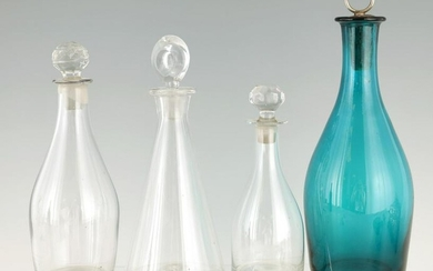 A SELECTION OF FOUR GEORGIAN GLASS DECANTERS of ta