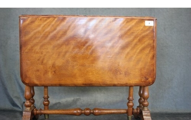 A Victorian satinised mahogany Sutherland table, on twin tur...