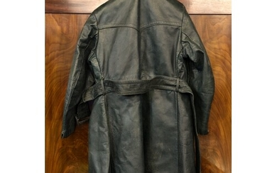 A WW2 German dispatch riders green leather coat, with attach...