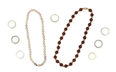 A gold and cornelian bead necklace