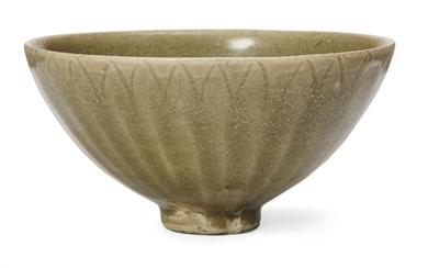 A grey stoneware celadon glazed moulded bowl, 15th/16th century, moulded...