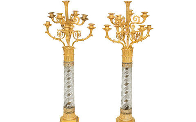 A pair of early 19th century gilt bronze and cut glass nine light candelabra