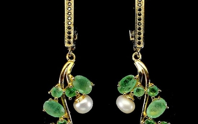 A pair of emerald and pearl ear pendants each set with numerous circular- and oval-cut...