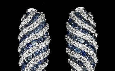 A pair of topaz and sapphire ear pendants each set with numerous circular-cut topaz and...