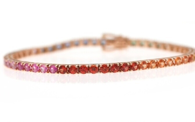 NOT SOLD. A sapphire bracelet set with numerous circular-cut sapphires, mounted in 18k rose gold....