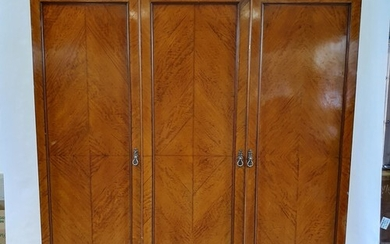 A satinwood triple wardrobe, retail label for S & H Jewell, ...