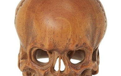 A signed wood model of a skull, Meiji-Taisho period, Japan, early 20th century, 4cm. high Provenance: Private Collection Oliver Hoare (1945-2018); John Harwood 1 July 1997