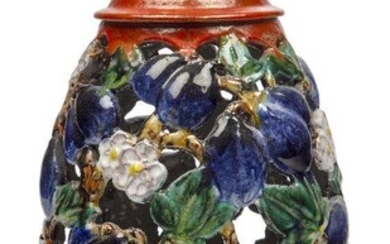 An Austrian Pottery terracotta openwork vase and cover in the Viennese Gmundner style, c.1920, indistinct pottery marks, impressed Made in Austria and 115, The oviform reticulated and decorated with plums, leaves and flowers, colourfully glazed...
