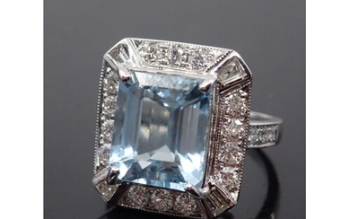 An aquamarine and diamond cluster ring set in 18ct gold fing...