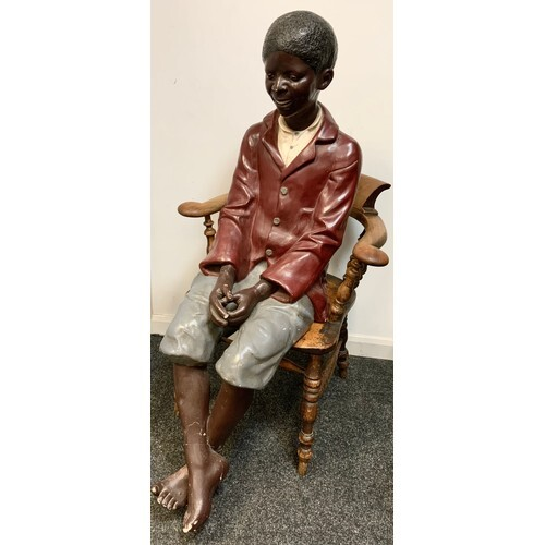 An early 20th century plaster life size model, of a black bo...