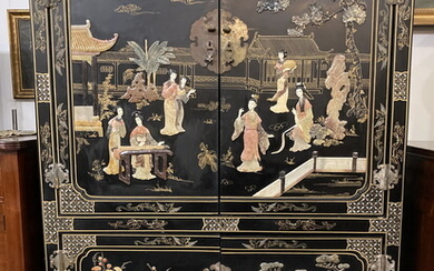 CHINESE COROMANDEL FOUR-DRAWER BLACK LACQUERED CABINET . Applied multi-color hardstone...