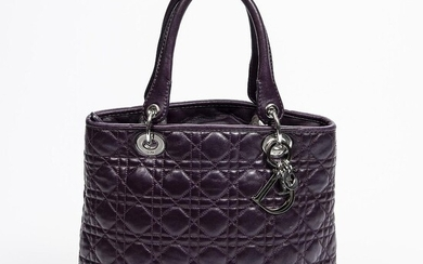 """Christian Dior: """"Lady Dior Soft Shopping Tote"""" A bag of purple cannage quilted leather with silver tone hardware. – Bruun Rasmussen Auctioneers of Fine Art"""