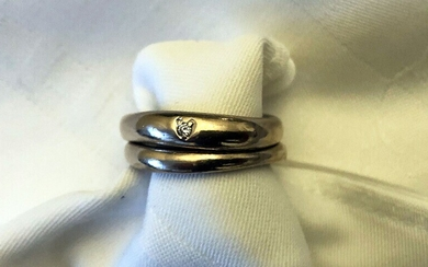 """Ole Lynggaard: """"Love"""". Two rings of 18k white gold, one set with brilliant-cut diamond. Design..."""