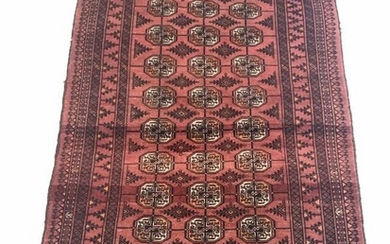 Persian Bokhara red ground rug, gul motif on red...