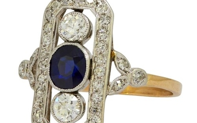 SAPPHIRE AND DIAMOND RING, set with a central blue sapphire ...