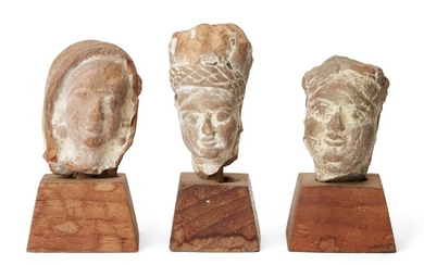 Three small sandstone carved heads, Gupta period, India, 3rd-4th century AD, on wood plinths, each approx. 3cm. high without plinth (3) Provenance: The private collection of Donald and Valerie Coombs. The Coombs lived in Mumbai (Bombay) from 1967...