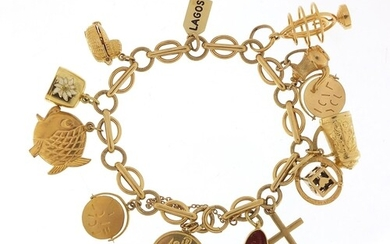 9ct gold charm bracelet with a selection of mostly gold char...